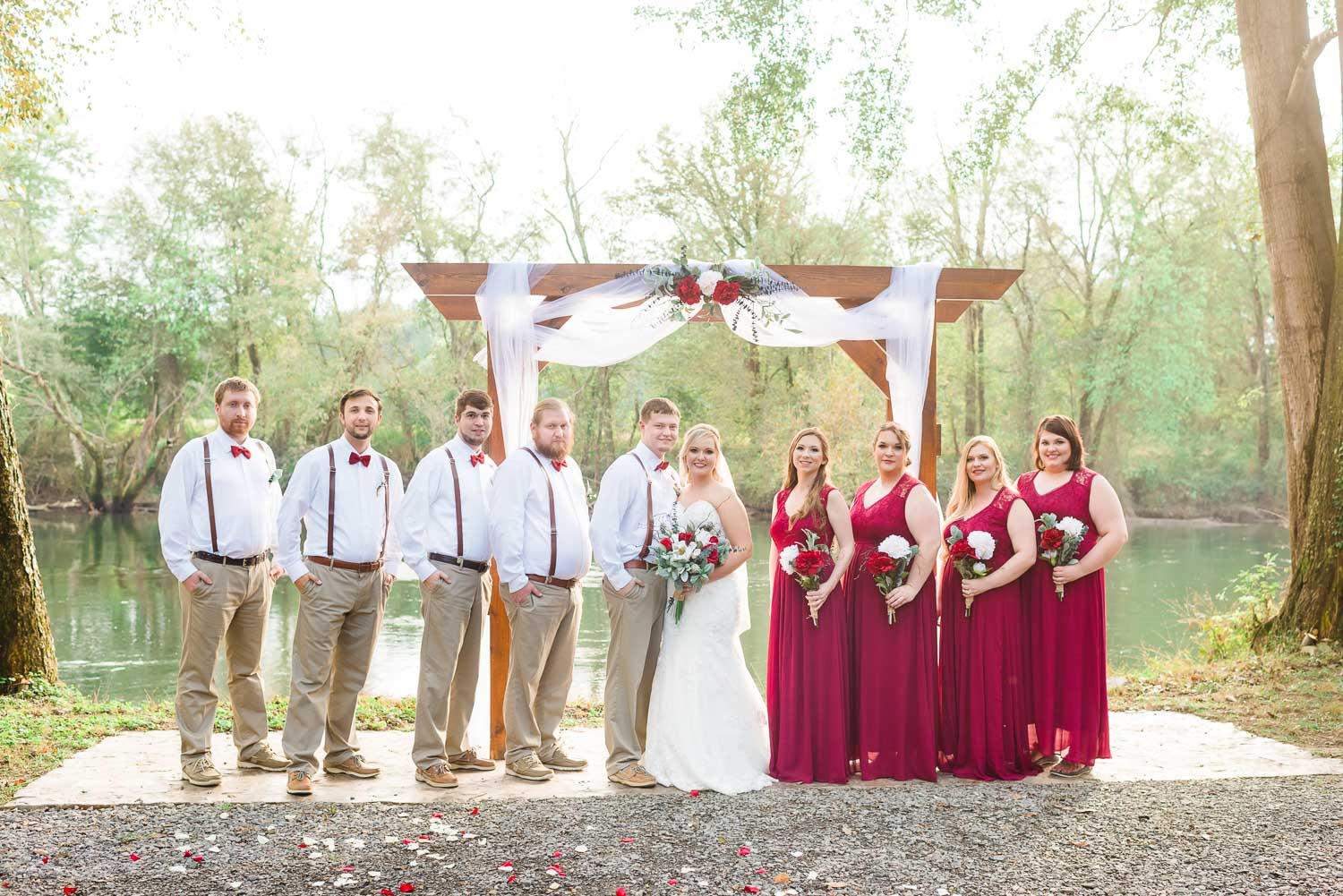 fall wedding with girls in bold cranberry red dresses and guys in tan and white