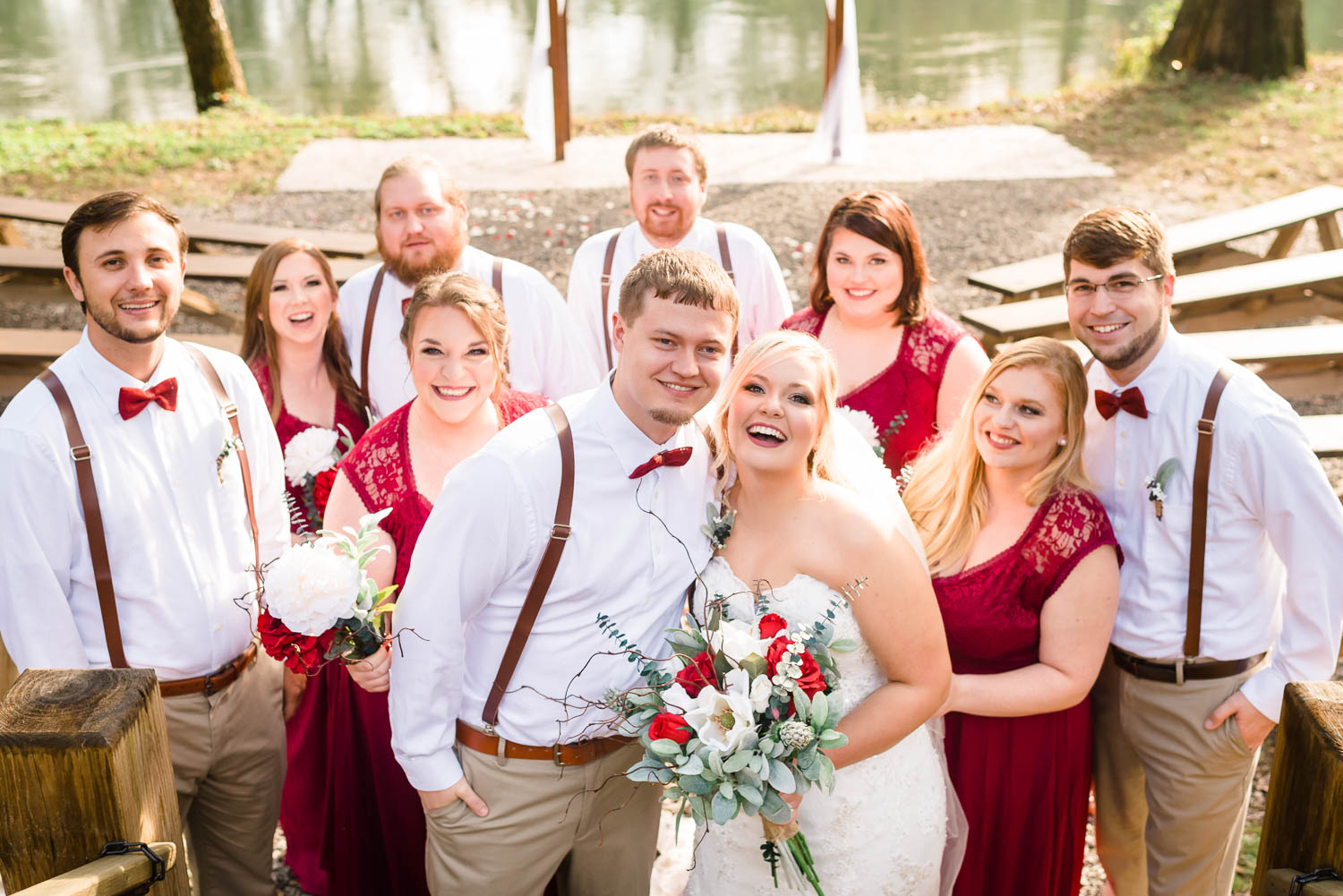 wedding party crowded in laughing and smiling outside in Tennessee