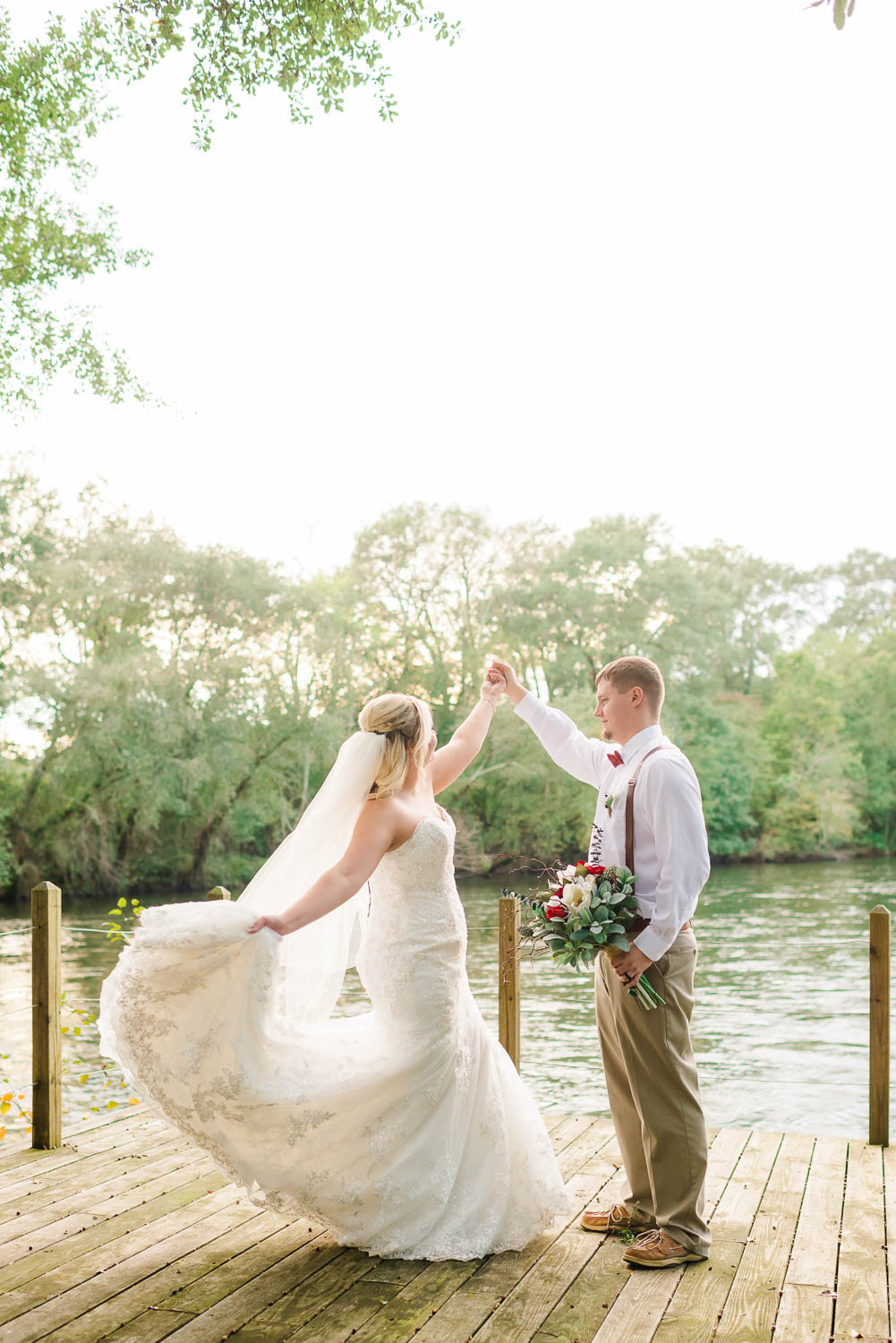 bride and groom dancing out on the dockat Hiwassee River weddings in October