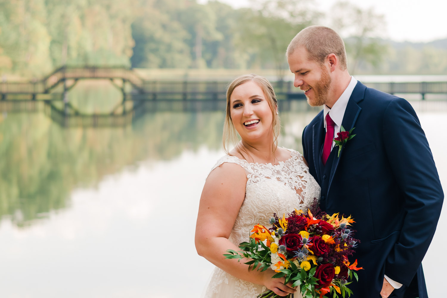 two people outside at wedding by pond at Indigo falls events in GA