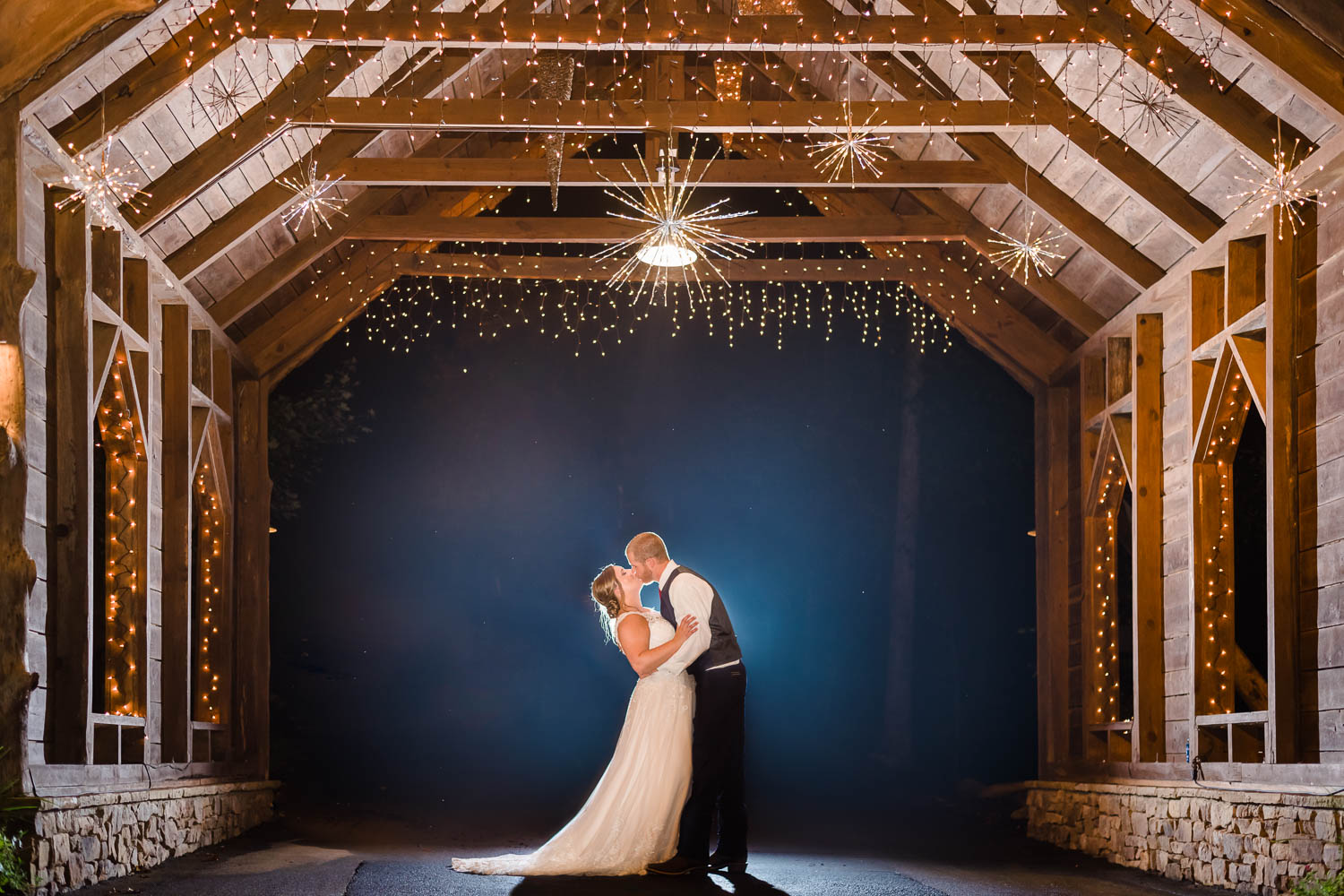 wedding couple at night in the fog under the covered bridge at Indigo Falls Events in Dallas GA