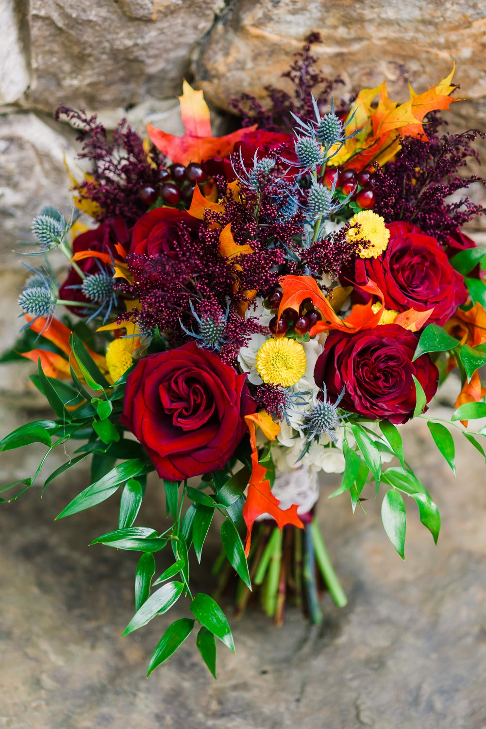 fall reds and oranges in this wedding bouquet by A Perfect Wedding floral and design in Dallas GA