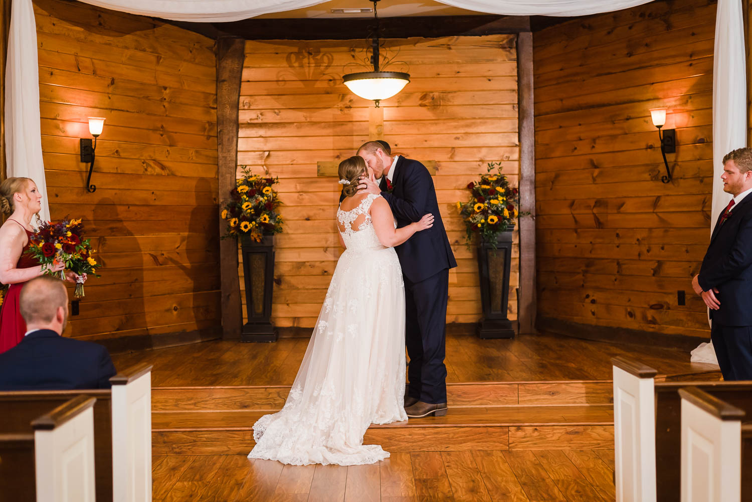 indoor wedding ceremony first kiss at Indigo Falls events in GA