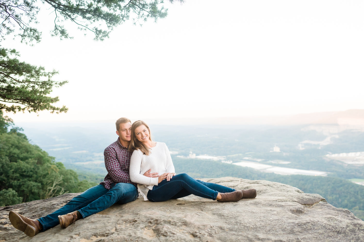 two people sitting on Sunset Rock on Lookout Mountain in the fall