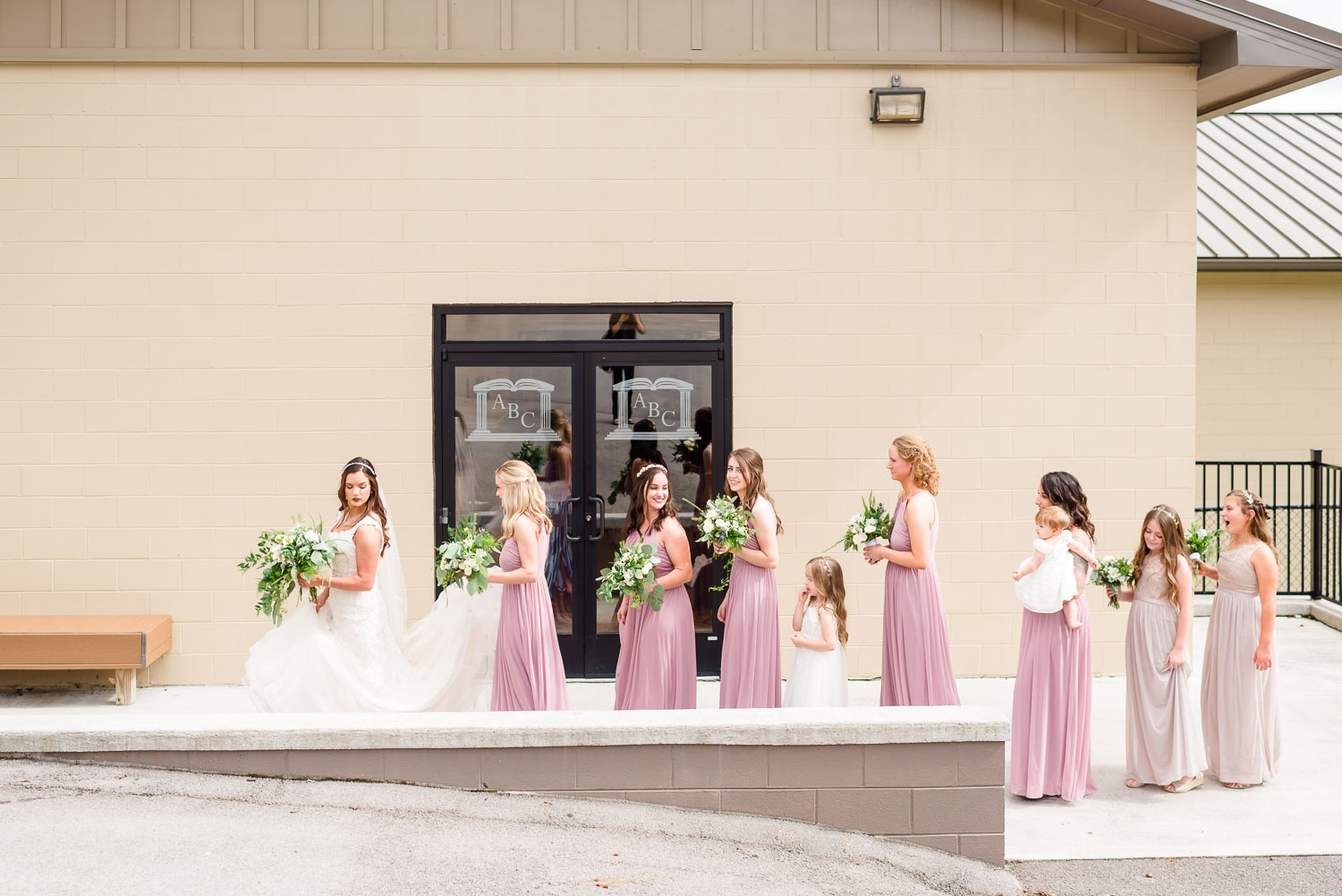bride and bridesmaids walking in front of church in Knoxville