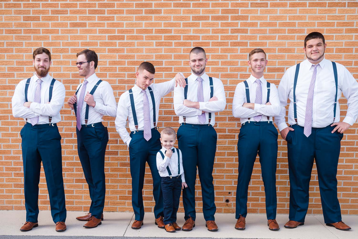 Groom and grooms men wearing white shirts and navy pants with lavendar neckties in Knoxville TN