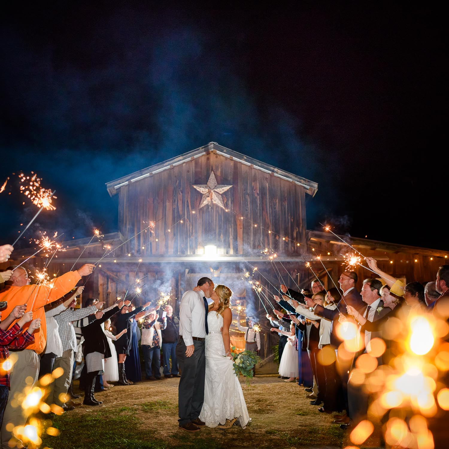 nighttime barn at drewia hill with sparkler send off