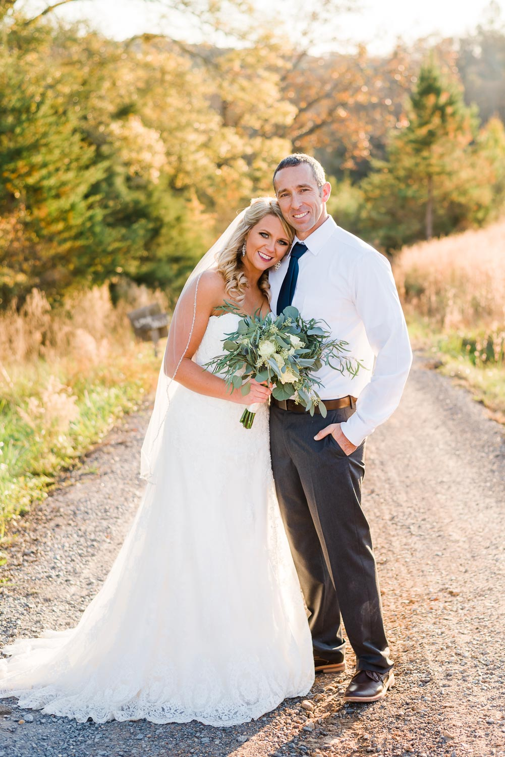 bride and groom smiling outside on a warm November day in TN