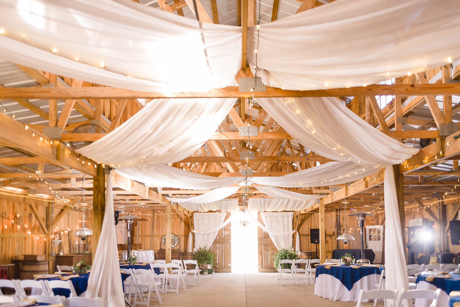 inside of the Barn at Drewia Hill in sale Creek TN decorated in Navy and white for fall wedding