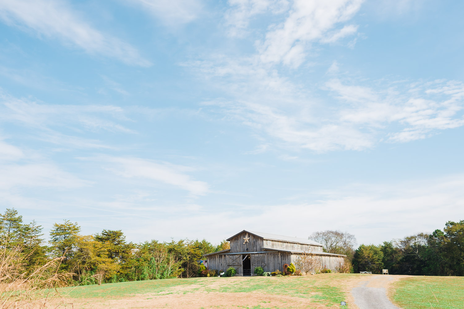 barn wedding venue in a field and lots of blue sky in Tennessee