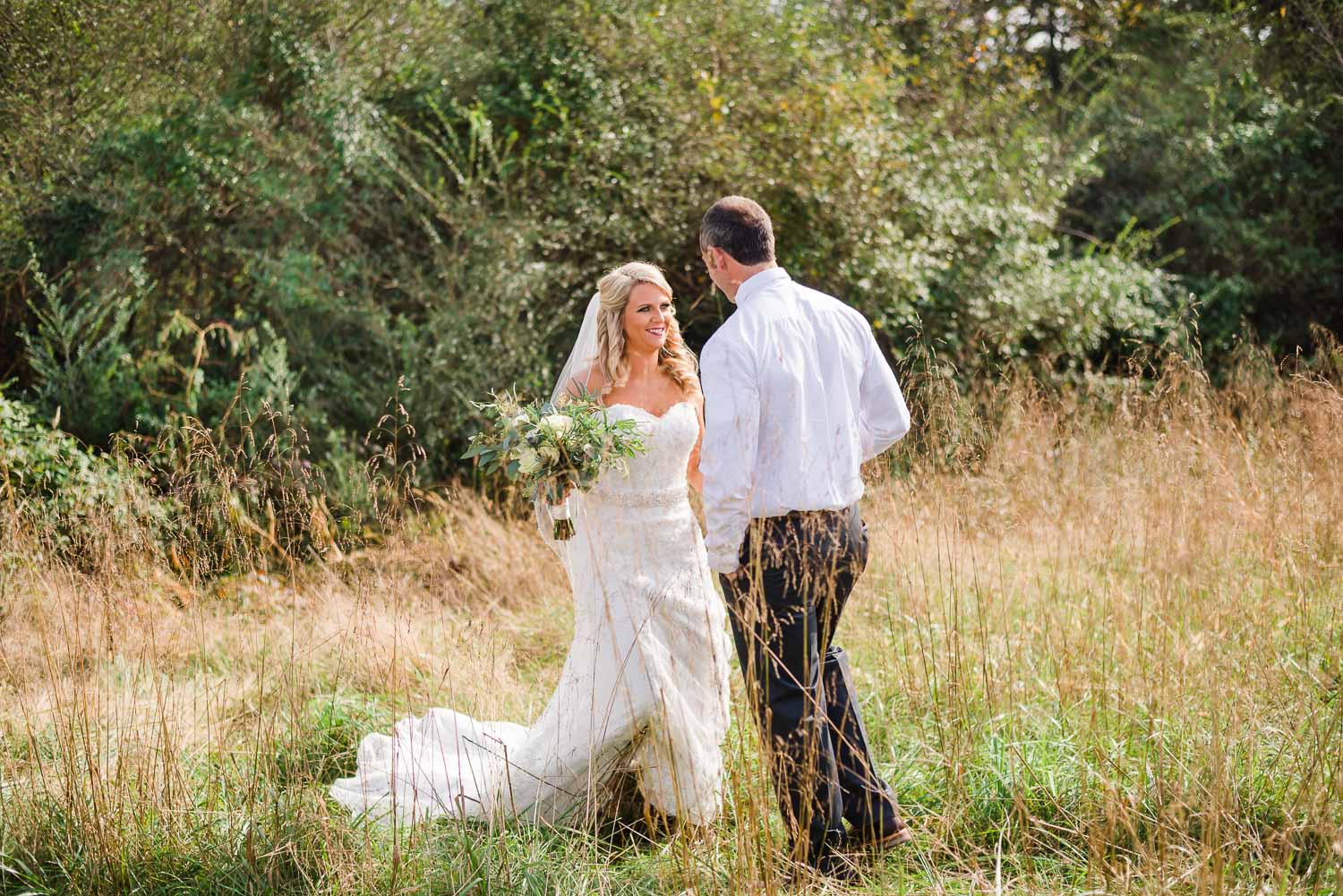 groom walking to his bride in tall grass in Tennessee
