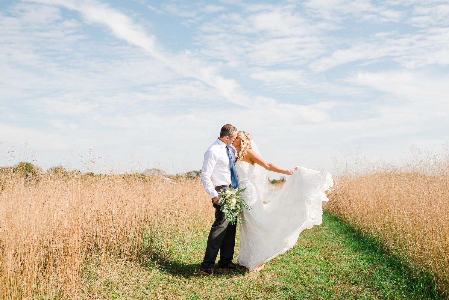bride and groom out in a field in Sale Creek TN
