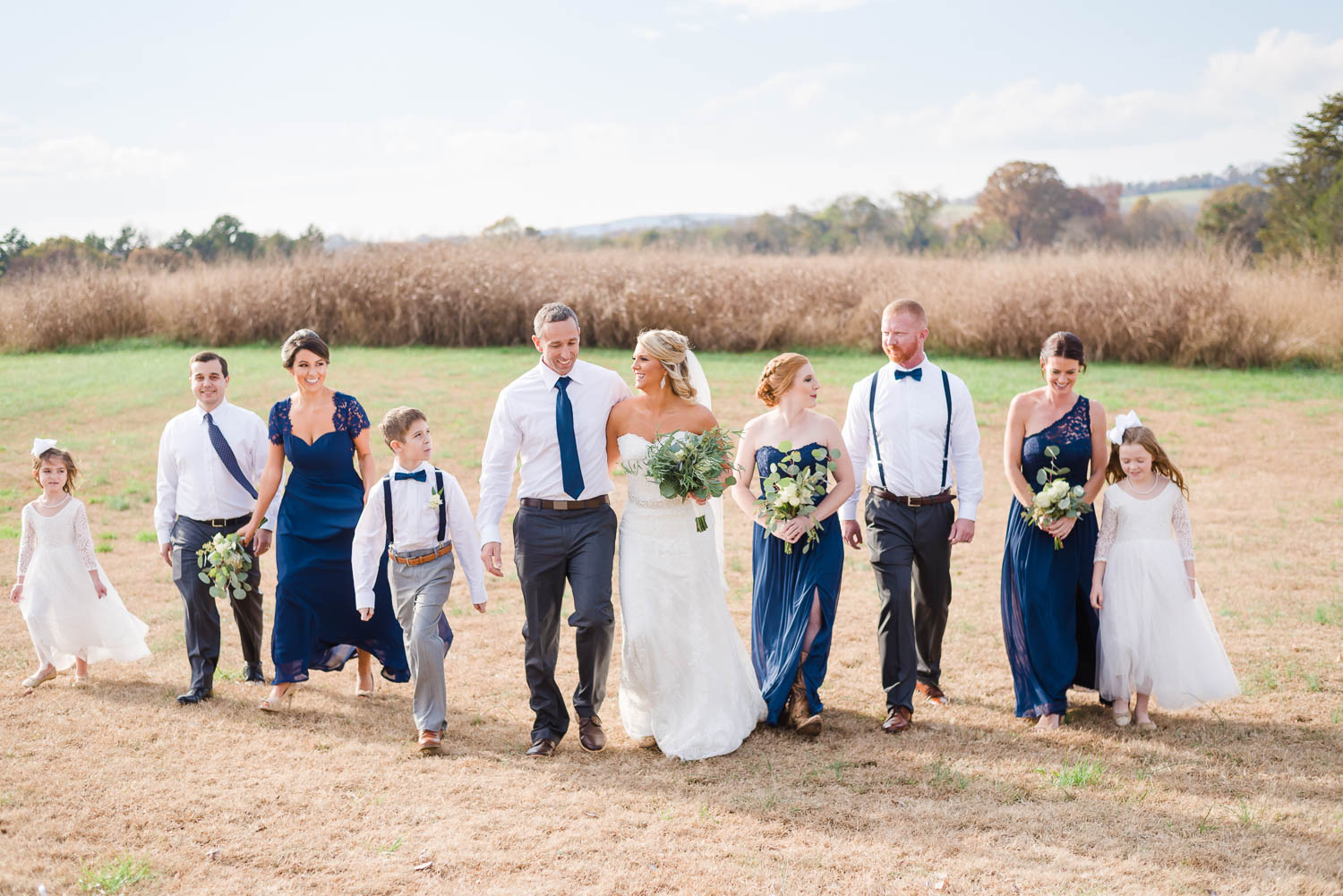 november wedding colors in navy dresses and guys in white shirts