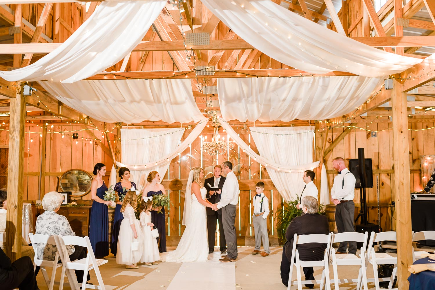 indoor fall wedding ceremony at the Barn at Drewia hill