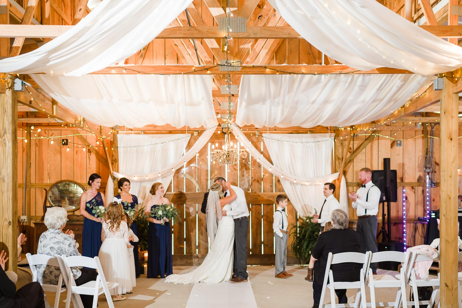 wide angle photo of indoor wedding ceremony at the barn at drewia hill.