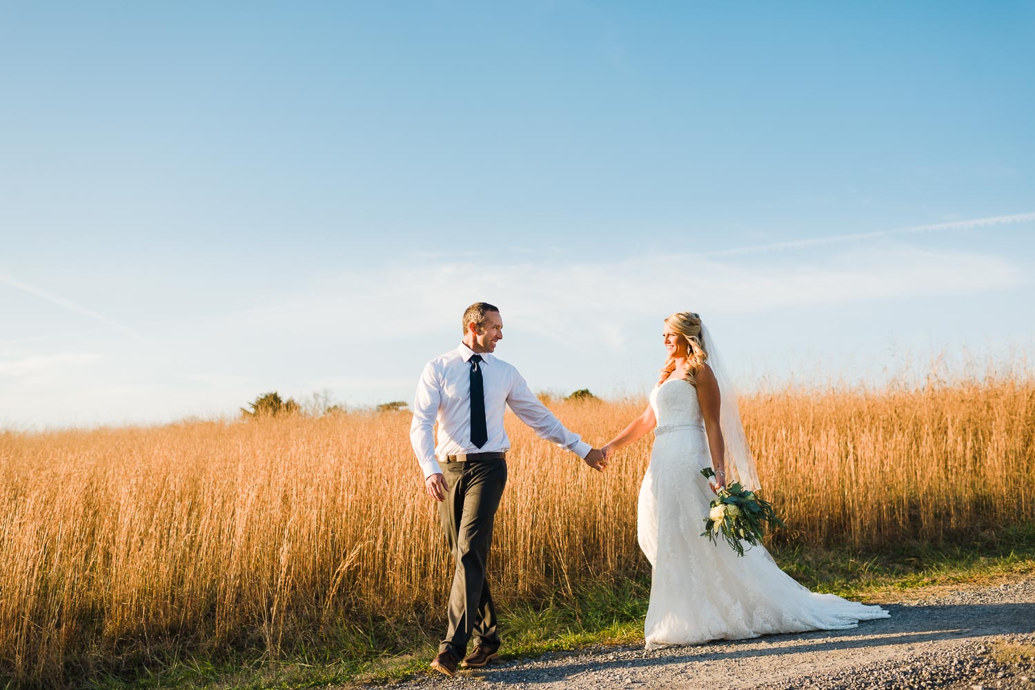 two people walking down road at their november tennessee wedding