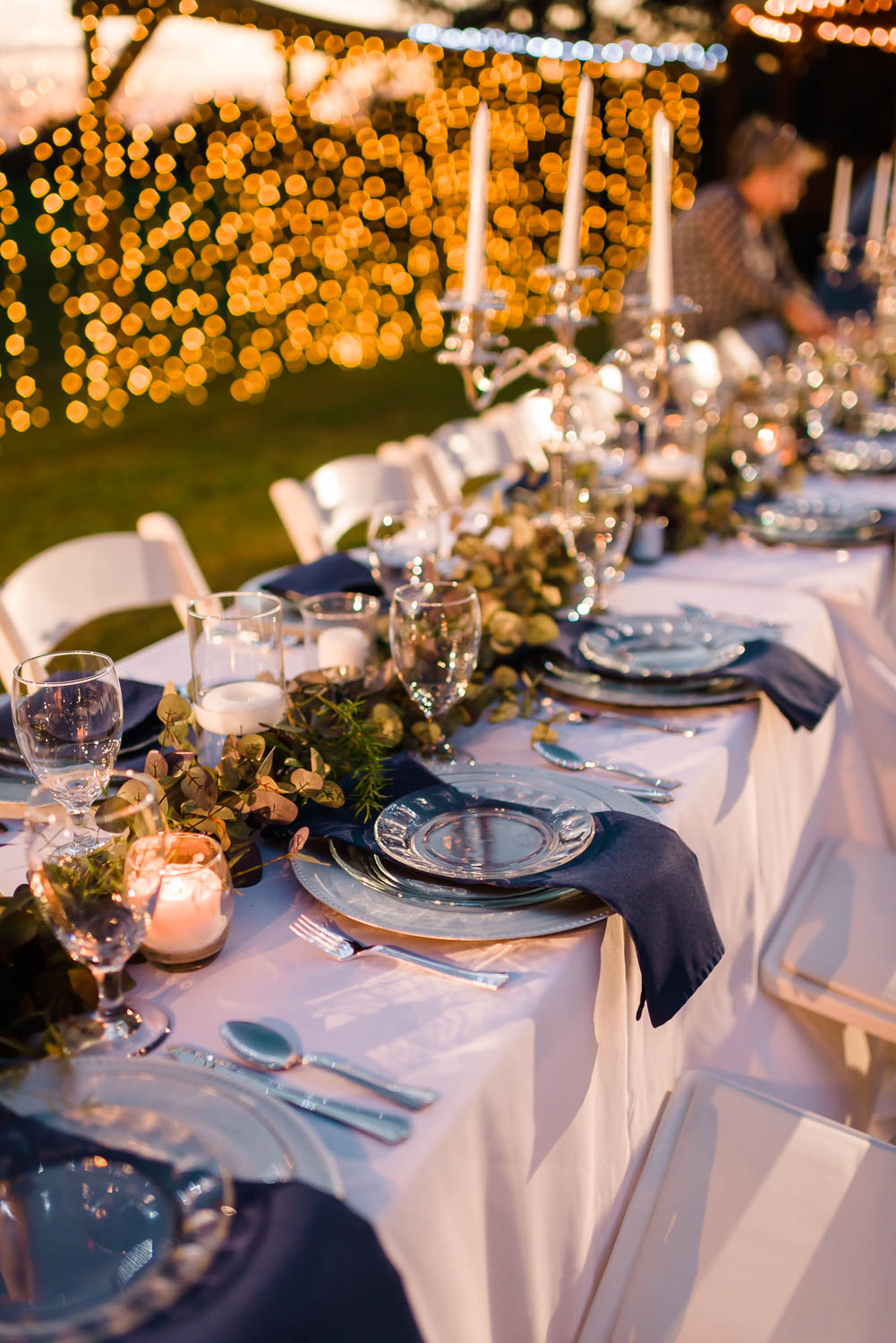 outdoor reception tablescape in navy, white and candle light