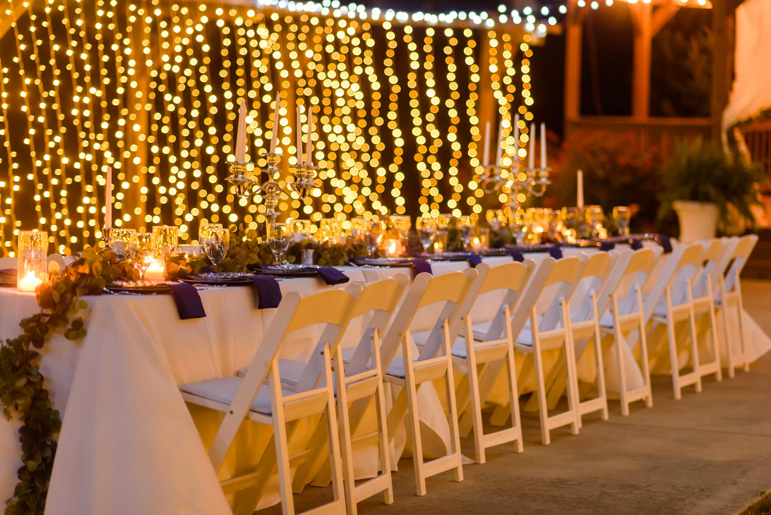 outdoor evening reception with candles and twinkly lights