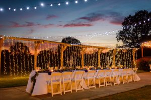 outdoor wedding reception with string lights at sunset in Trenton GA at Sunrise Farm