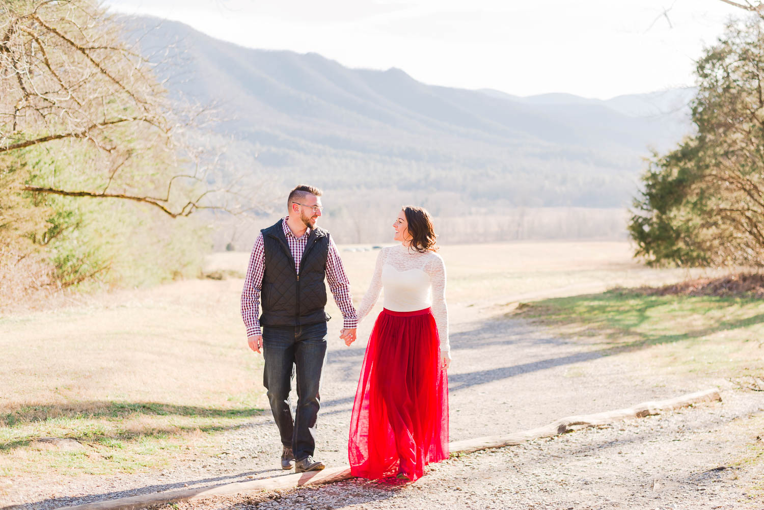 winter tennessee engagement photos of girl wearing red skirt and guy wearing navy and plaid