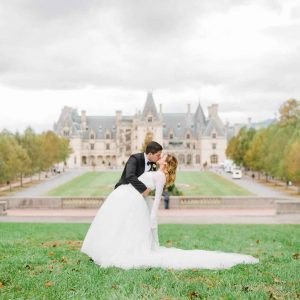 bride and groom in front of Biltmore in wedding attire