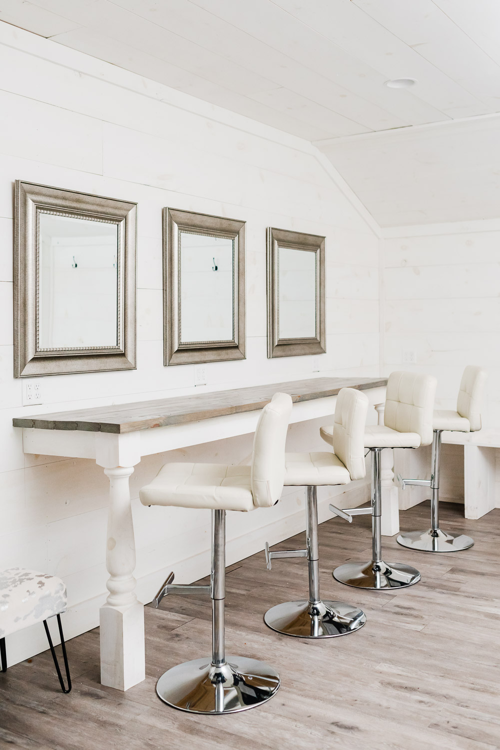 white swivel tall chairs in front of mirrors in the bridal suite at circle B Events