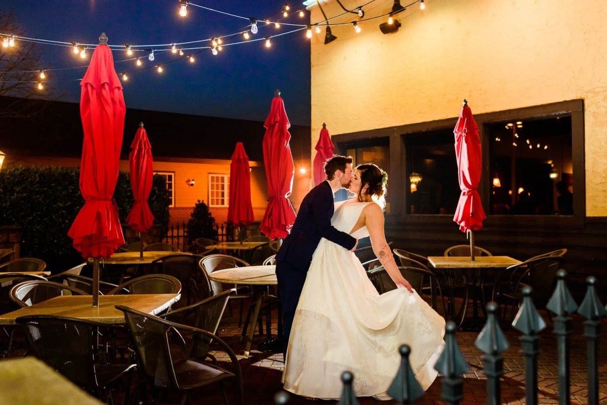 bride and groom in the court yard at Parkside Grill in Knoxville on Peters rd at night