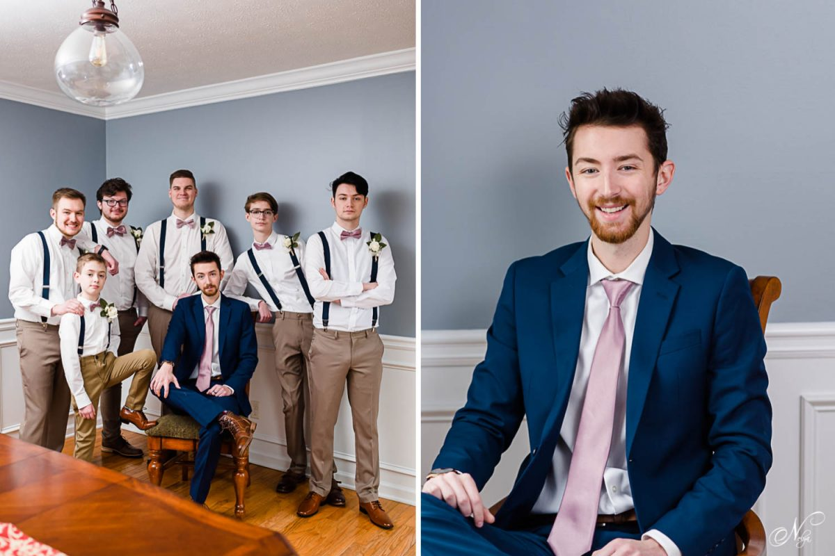 groomsmen in tan pants and navy suspenders.. And groom wearing a dusty pink colored tie and navy suit.