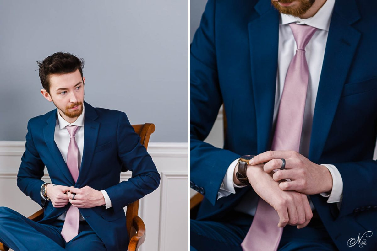 guy in blue suit in a chair by a window. and hands winding a watch.