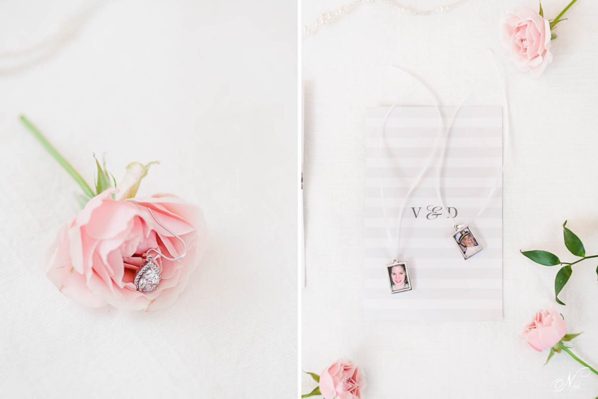 pink rose with wedding jewelry on a white background. and two keepsake photos in miniature frames.