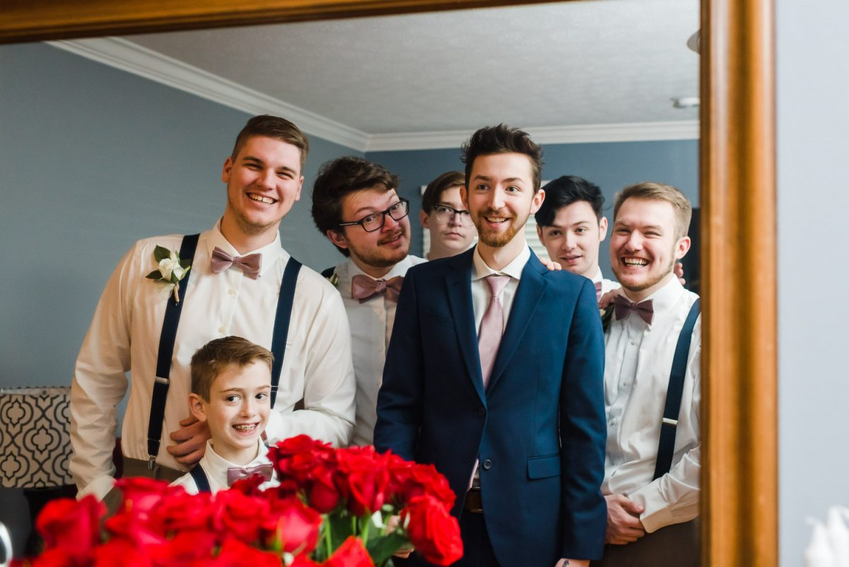 groom and groomsmen reflected in a mirror