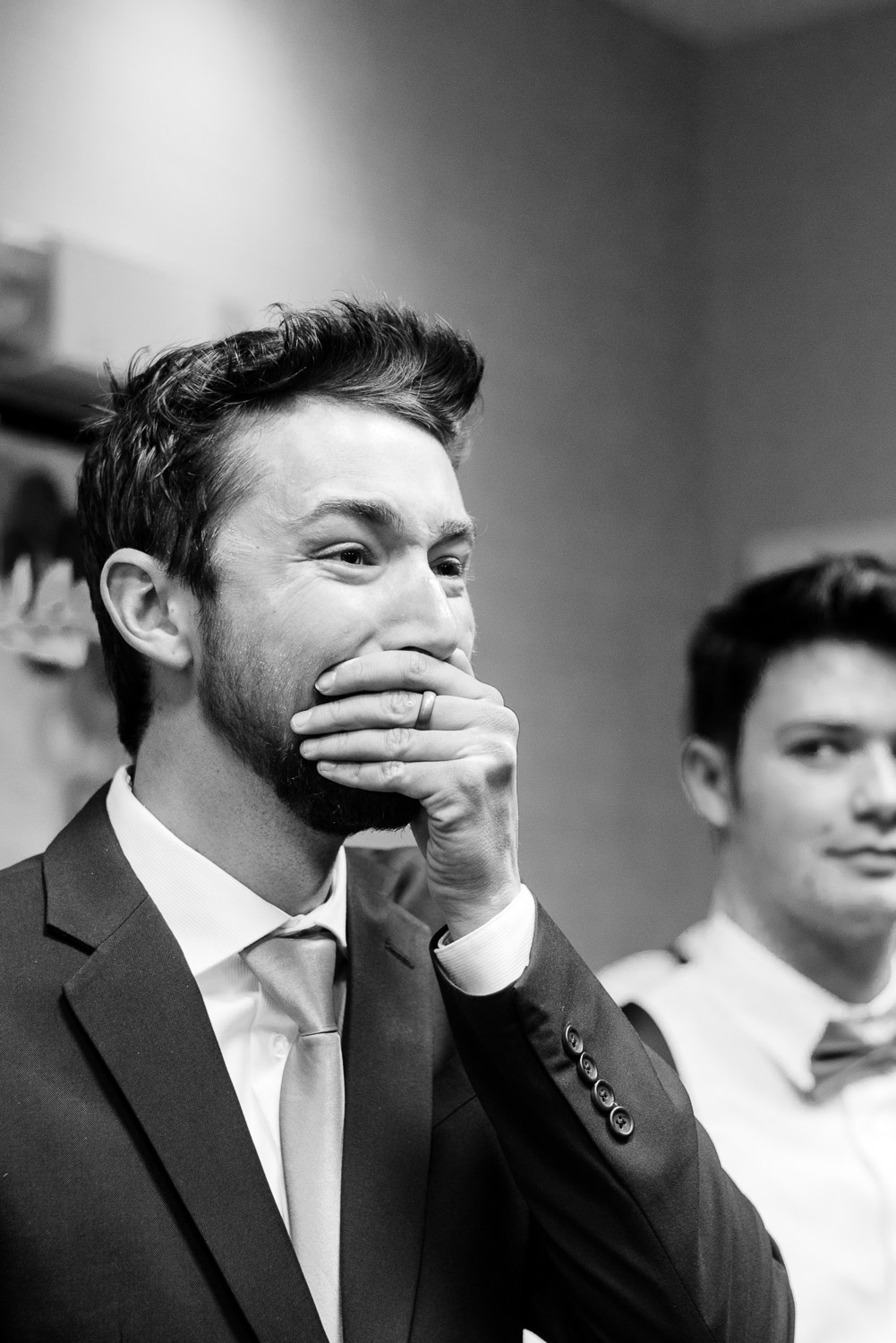 groom's reaction to seeing his bride walk in the room at their hotel wedding ceremony