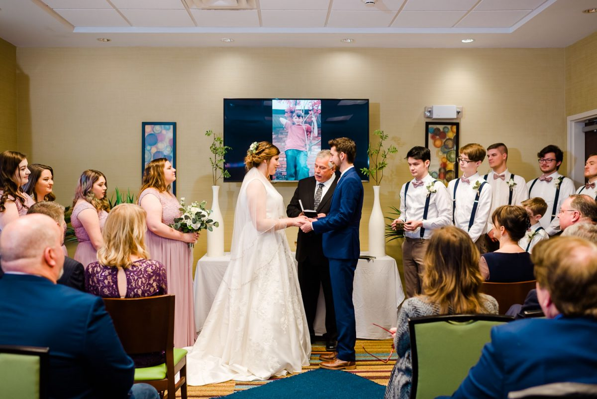 imprompto wedding ceremony in a hotel confirence room due to all the flooding in Knoxville