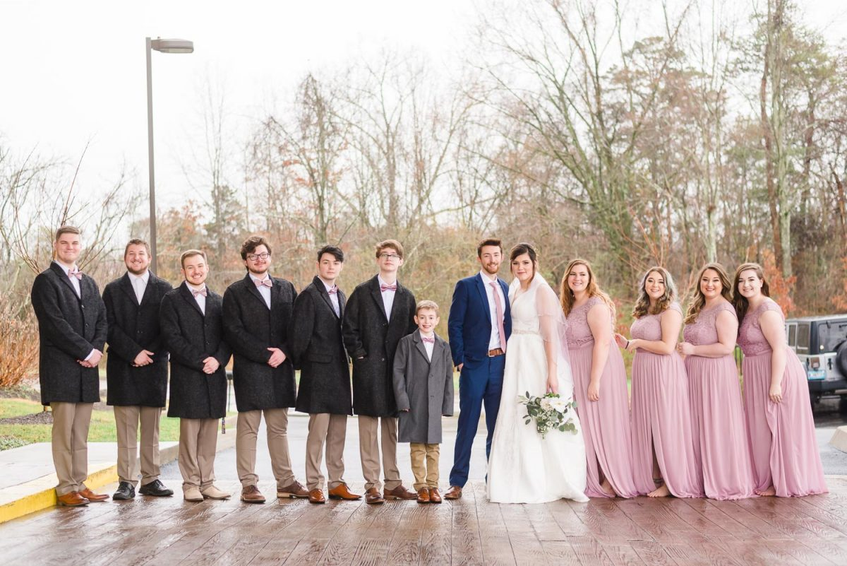 guys in charcoal colored jackets and bridesmaids in pale lavendar dresses.