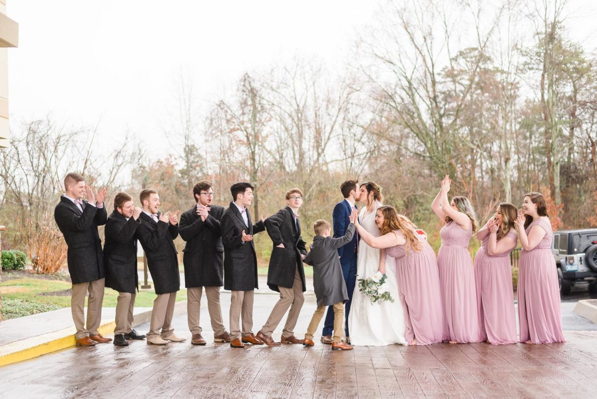 full wedding party under the portico at the Fairfield inn in west knoxville