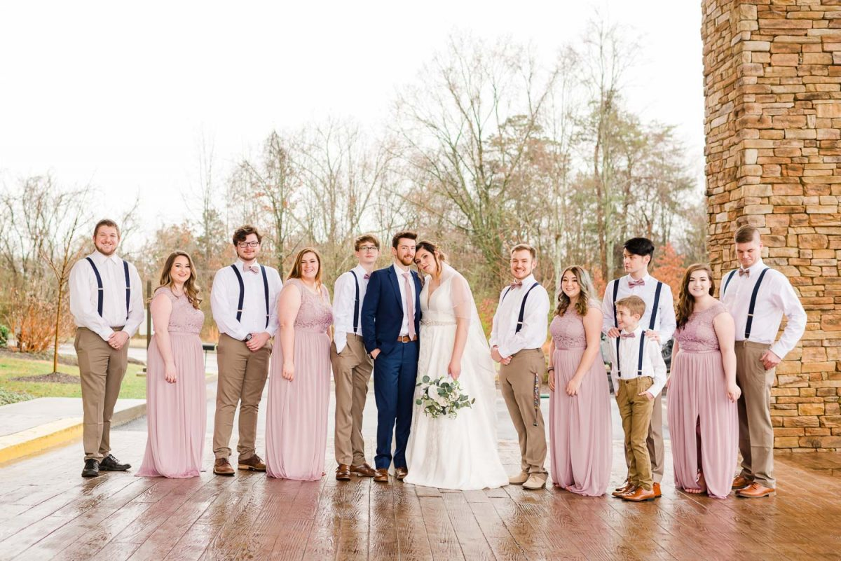 pink and navy wedding party outside at fairfield inn