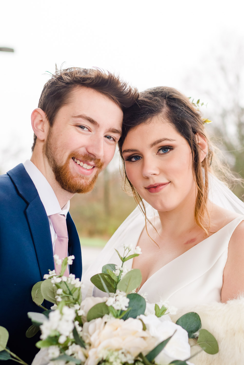 happy wedding couple with white bouquet