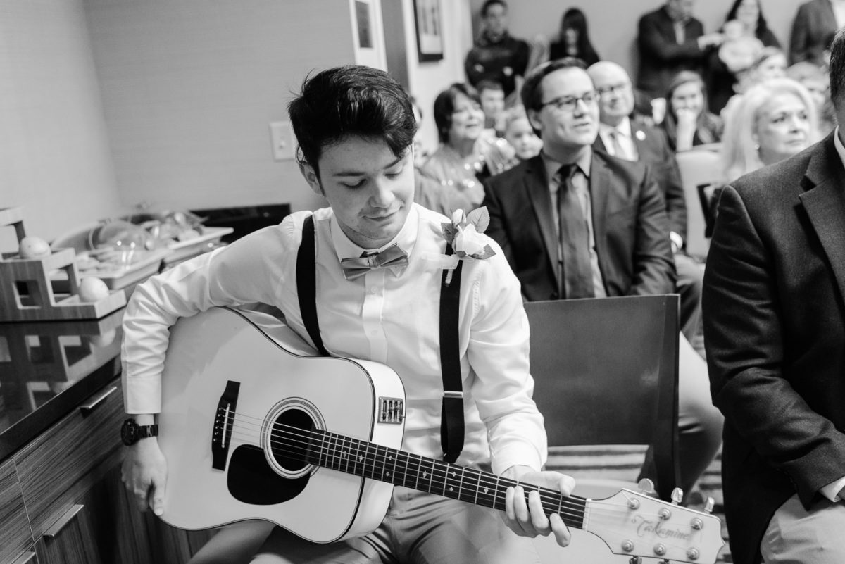 knoxville musicial playing guitar at wedding