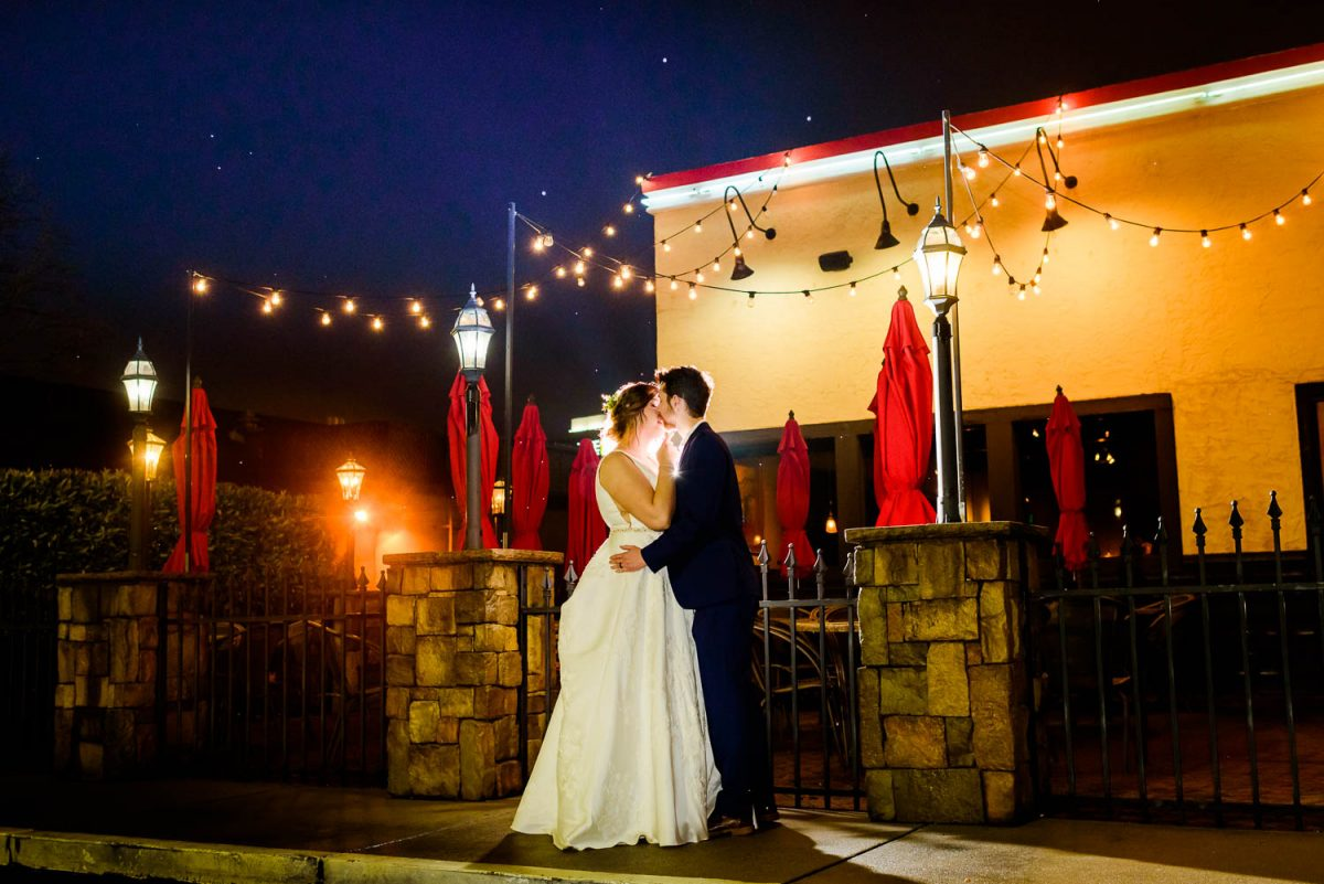wedding couple on the sidewalk in front og parkside grill in west knoxville TN