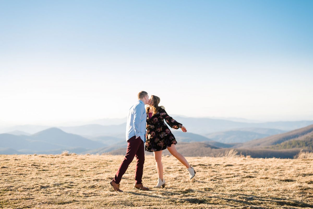 couple hugging at the top of Max Patch Mountain in Hot Springs NC