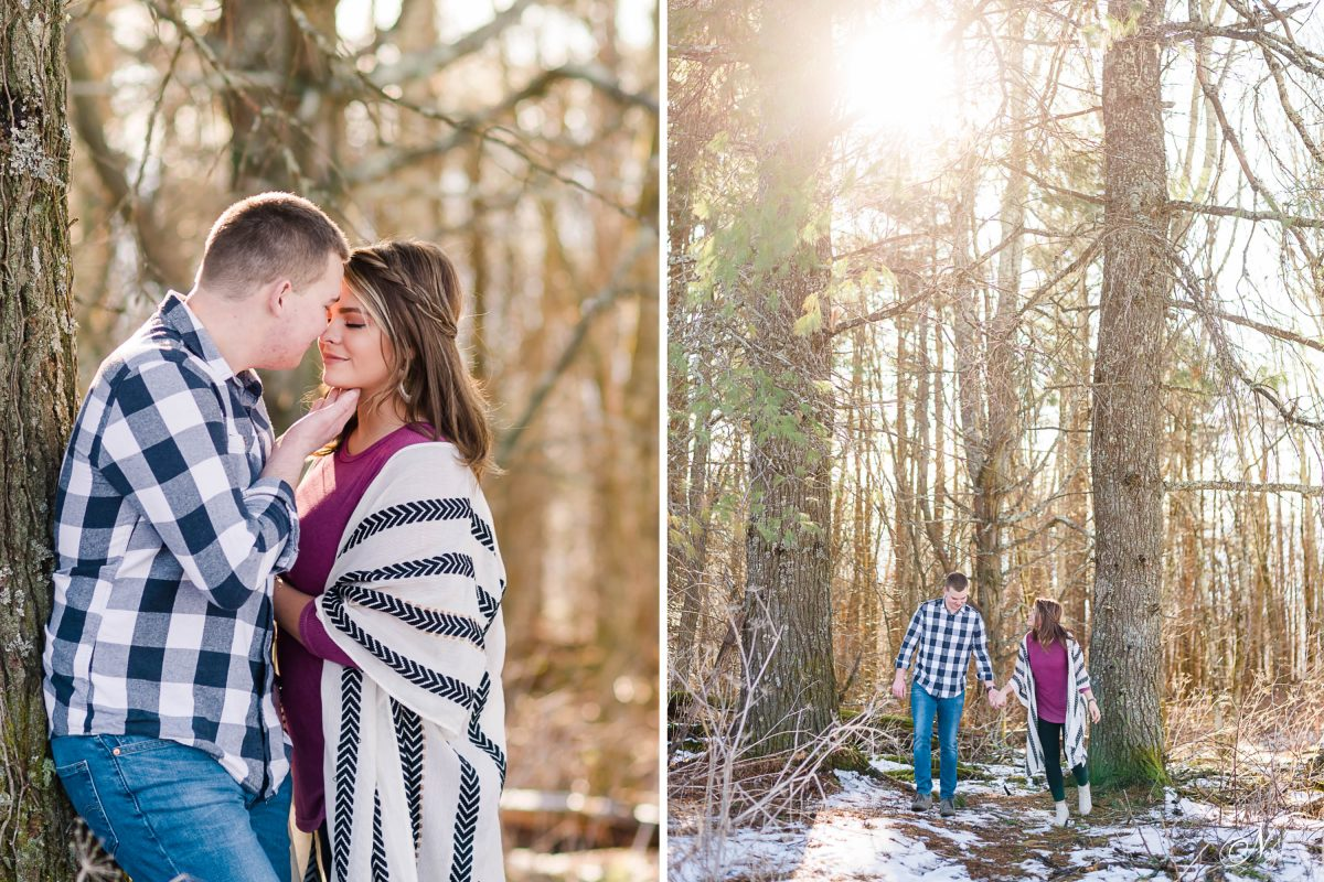 two people in the woods in February with snow on the ground for engagement photos