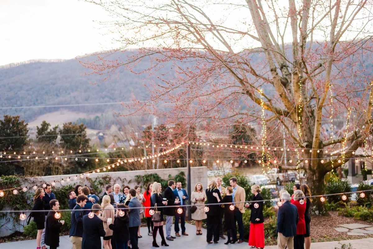 the garden at the Venue Chattanooga in the winter with guests outside enjoying coctail hour