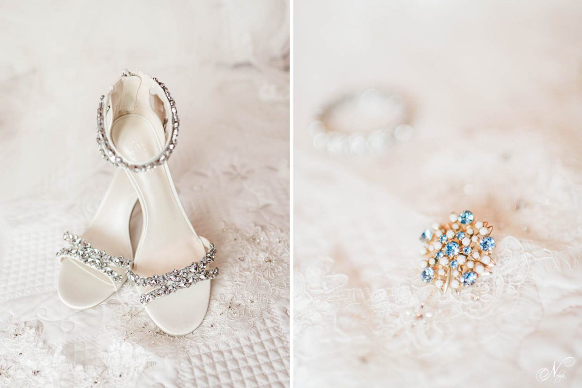 white wedding shoes and a blue and gold pin on a white background