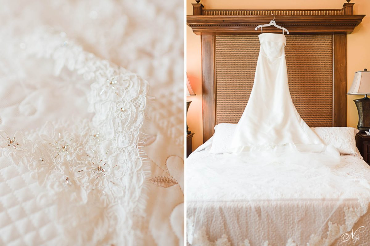 lacedetails on a veil. And wedding dress hanging in a bedroom.