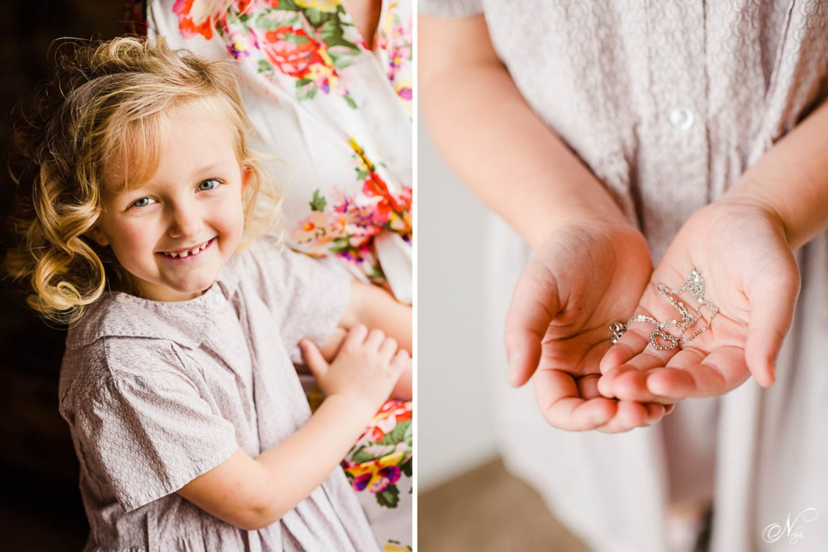 Flower girl smiling in a lavendar dress. And child's hands holding a heart shaped necklace