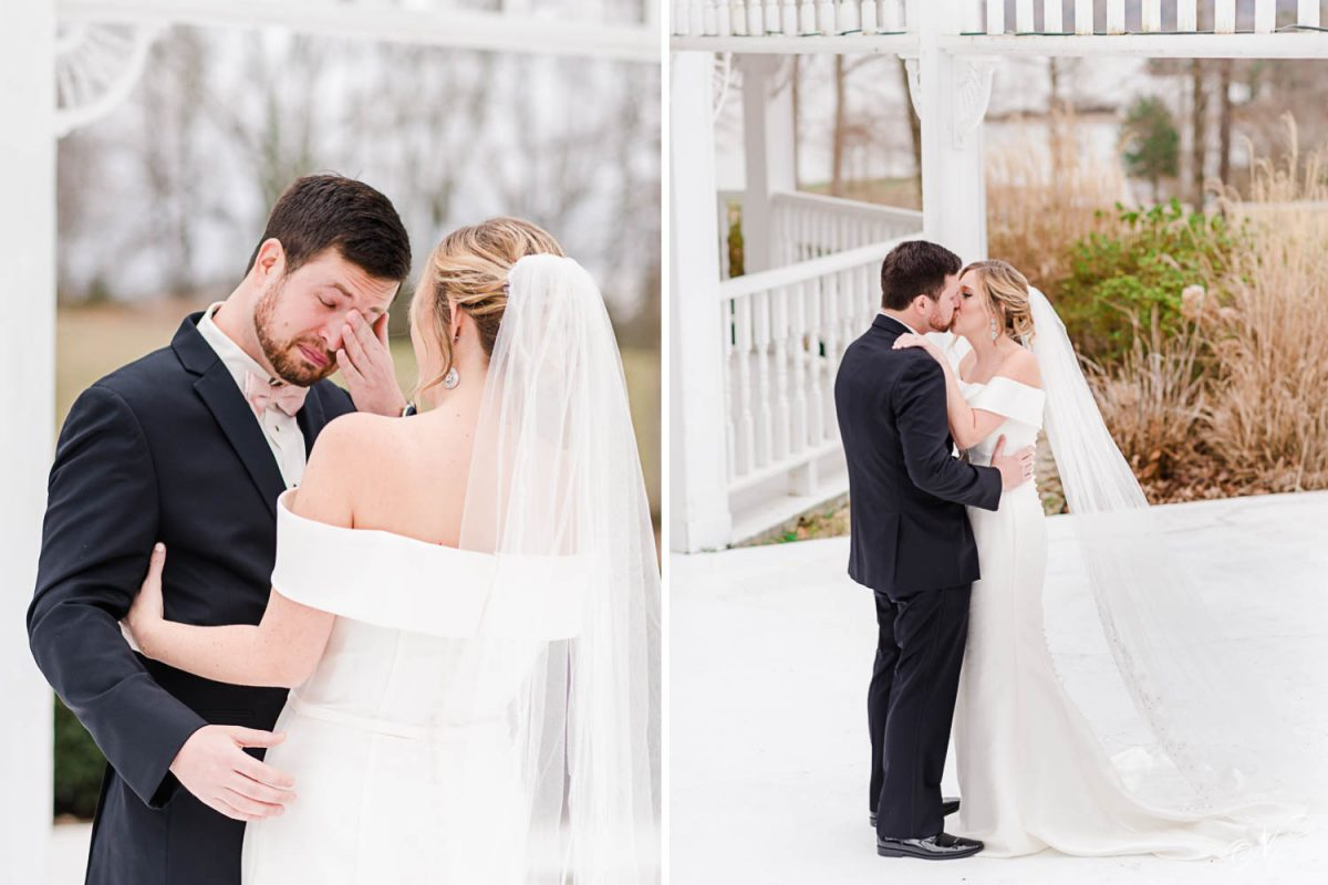 groom wiping tears from his eyes as her looks at his bride on their wedding day.