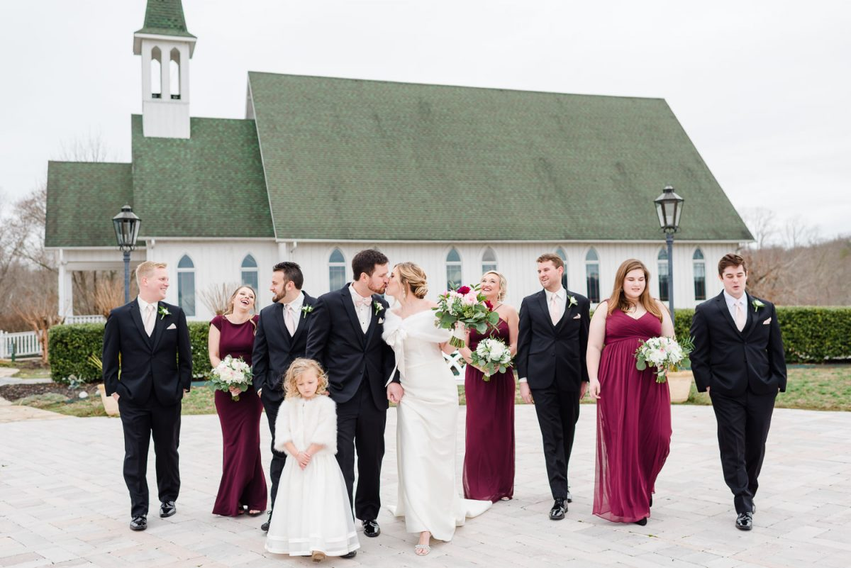 wedding party in maroon, white and black outside of the Chapel at Whitestone Inn near Knoxville.