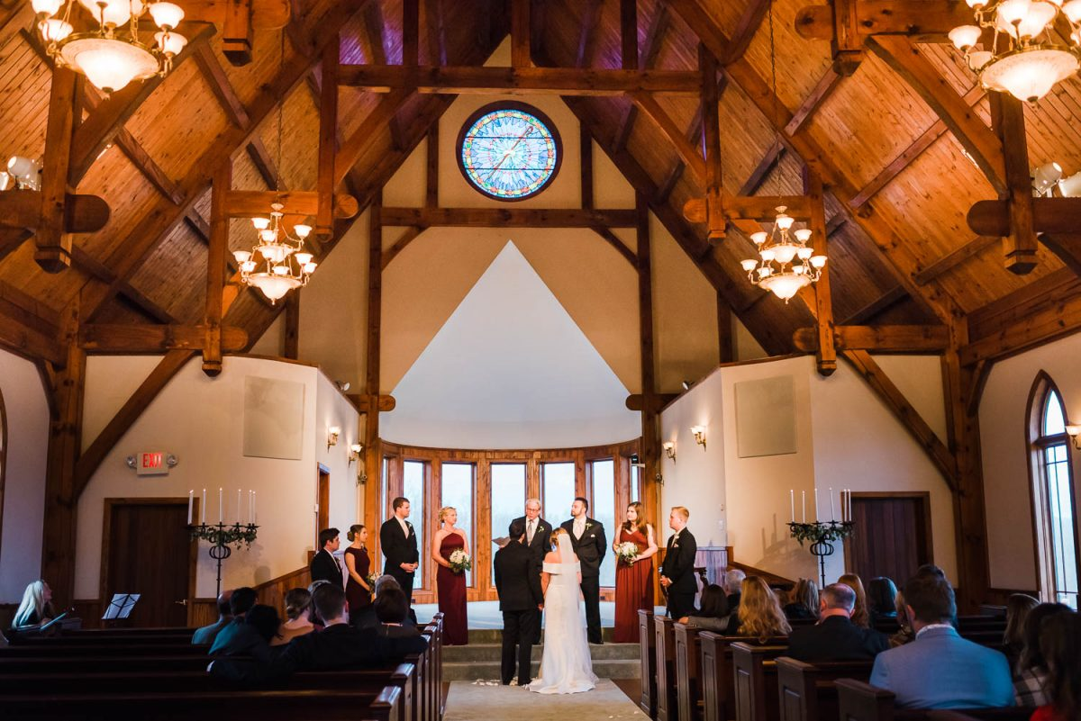 wedding ceremony inside of the chapel at Whitestone Inn.