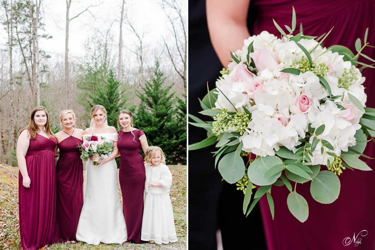 bride and bridesmaids outside standing near pine trees wearing wine colored dresses.