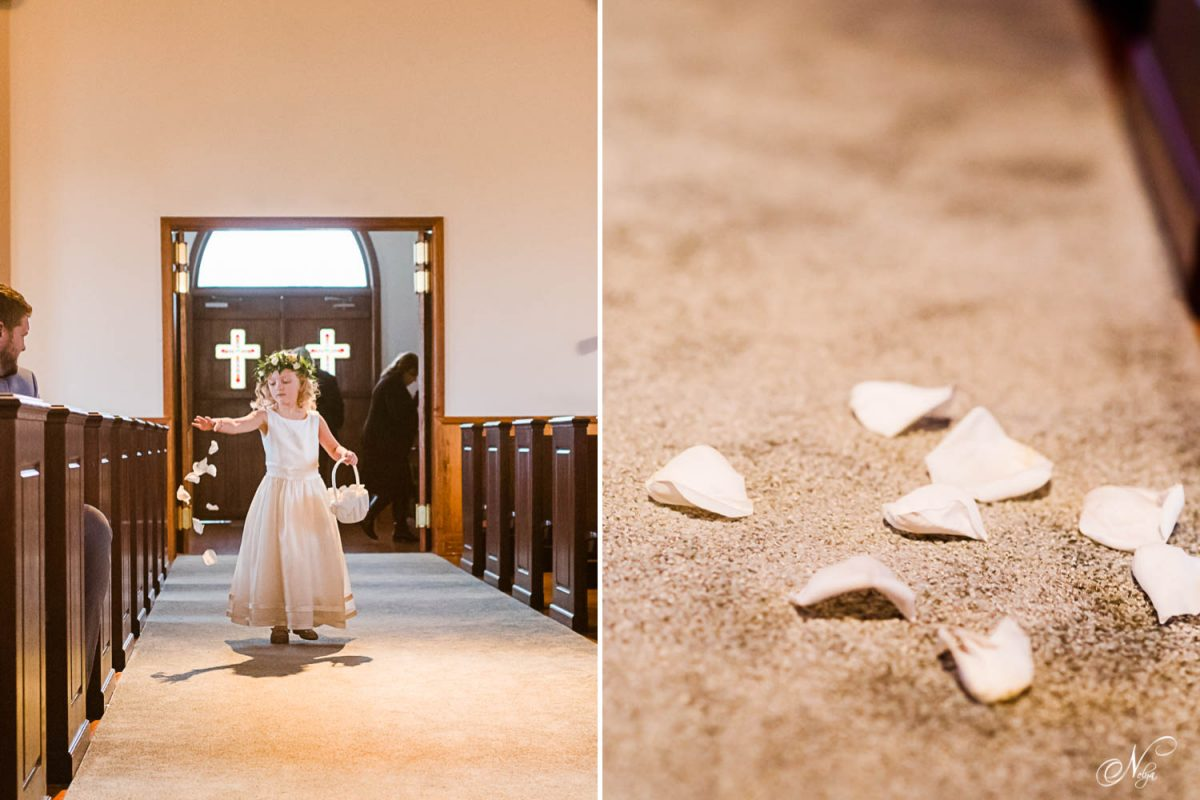 flower girl tossing flower petals at the chapel at Whitestone inn.